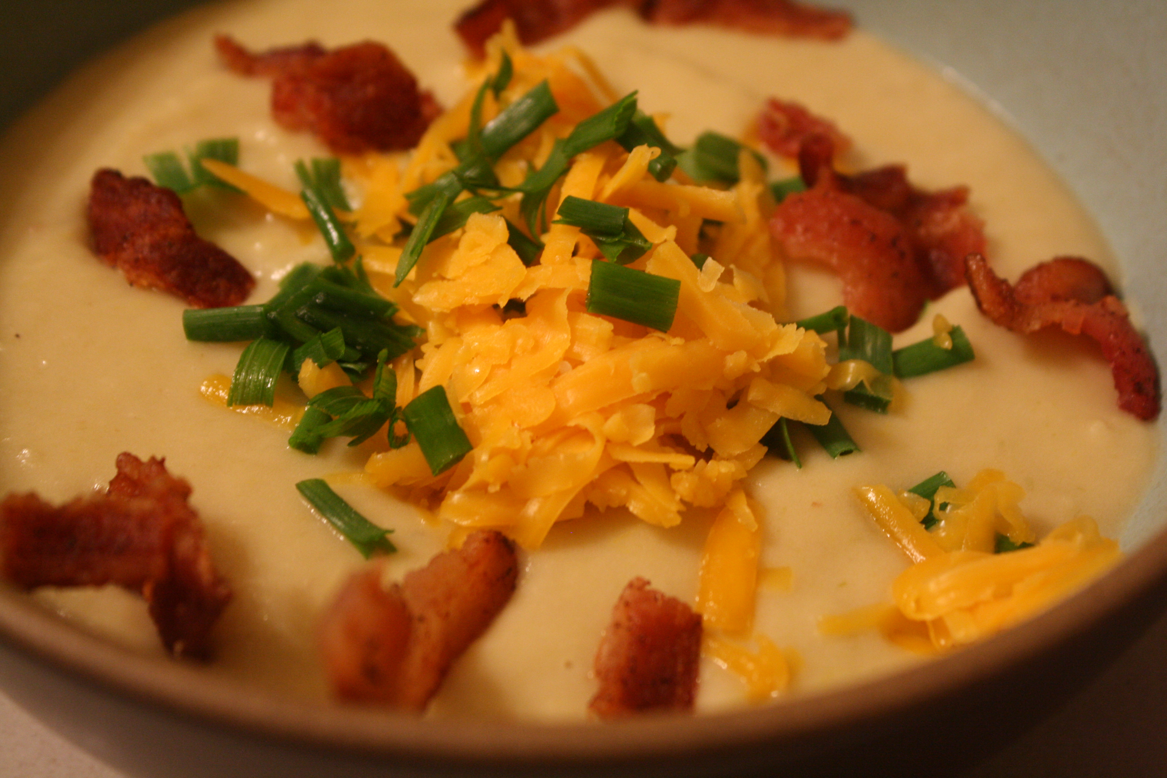 Potato leek soup with bacon and cheese topping