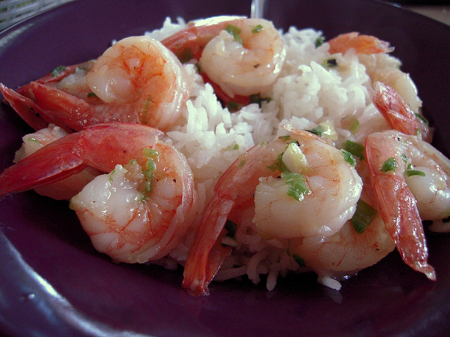 Baked shrimp served over rice