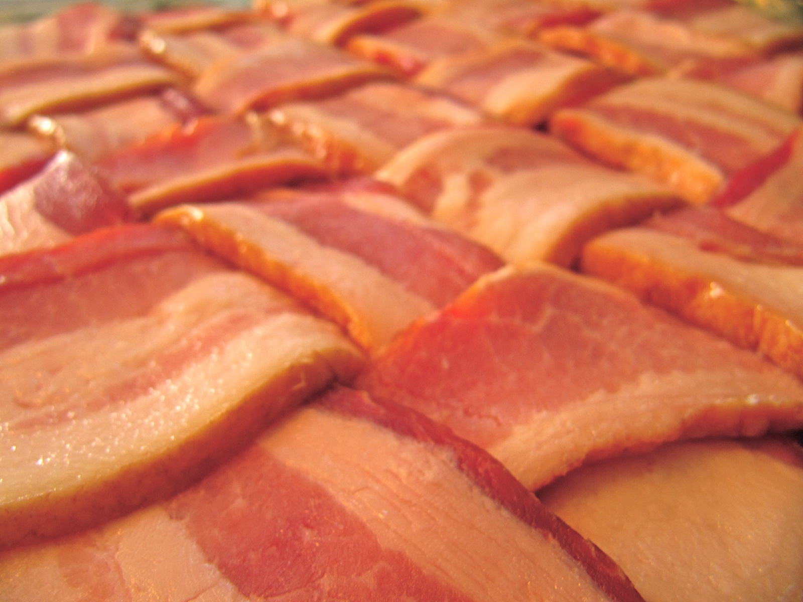 A raw bacon weave, ready to be wrapped around something